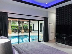 House for Sale Pattaya showing the master bedroom poolside