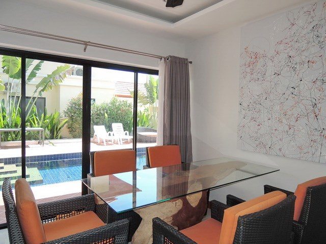 House for sale at Bangsaray Pattaya showing the dining area poolside