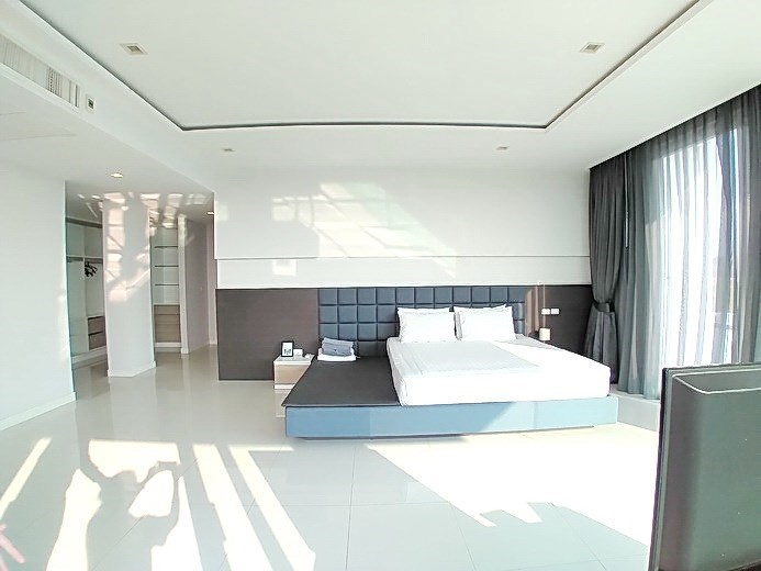 House for sale East Pattaya showing the master bedroom with walk-in wardrobes