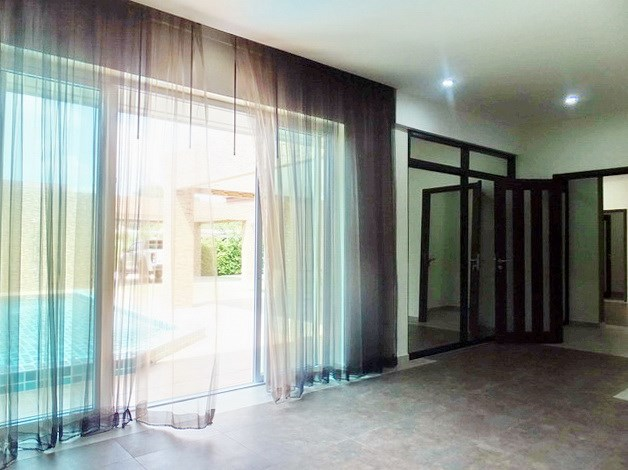 House for sale Huay Yai Pattaya showing the master bedroom poolside and built-in wardrobes