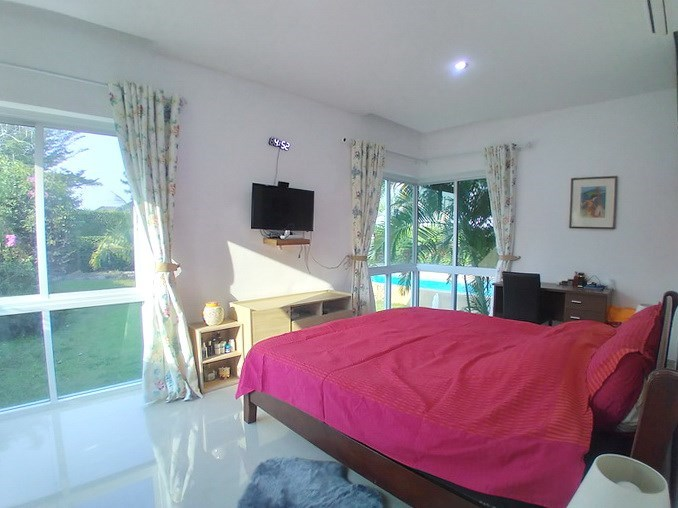 House for sale Huay Yai Pattaya showing the master bedroom with pool view