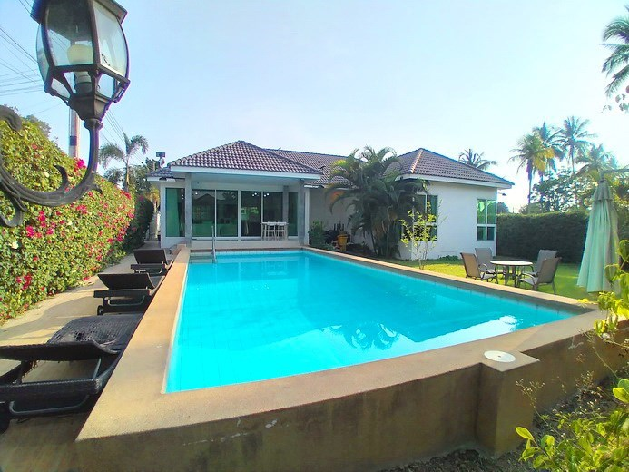 House for sale Huay Yai Pattaya showing the poolside terrace and house