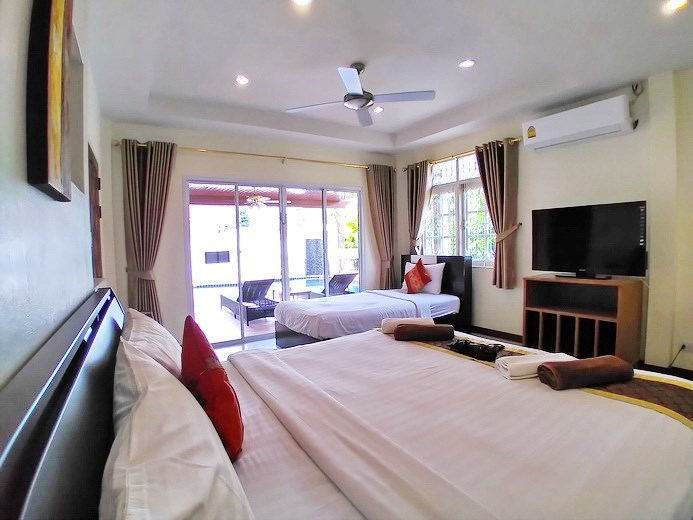 House for sale Jomtien showing the master bedroom pool view