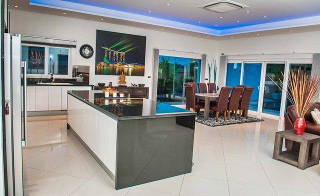 House for sale Mabprachan Pattaya showing the kitchen and dining areas