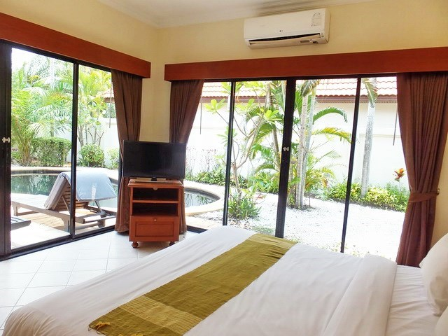 House for sale View Talay Villas Jomtien showing the second bedroom with pool view