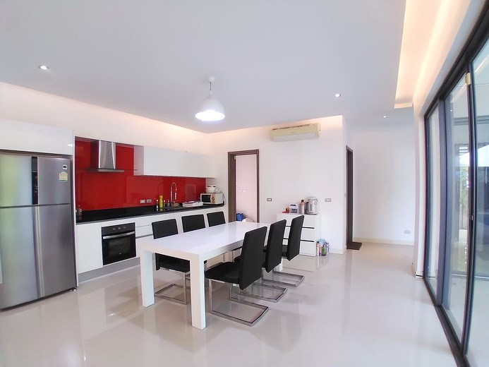 House for sale Mabprachan Pattaya showing the dining, kitchen and guest bathroom