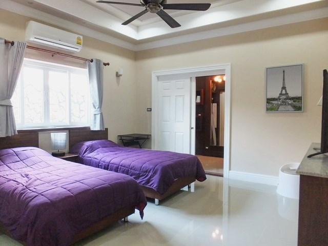 House for sale Nongpalai Pattaya showing the second bedroom with walk-in wardrobes
