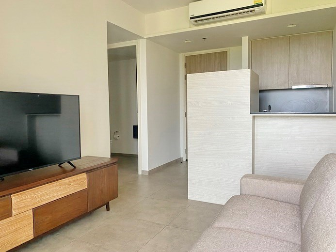 Condominium for rent UNIXX South Pattaya showing the living and kitchen areas