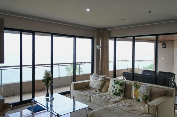 Condominium for sale Pratumnak Pattaya showing the living room with balcony access