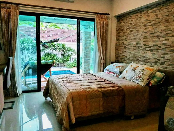 House for sale Huay Yai Pattaya showing the second bedroom poolside