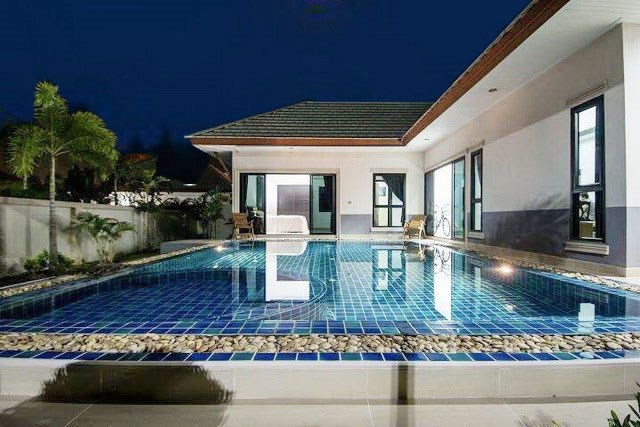 House for sale Na Jomtien Pattaya showing the terraces and pool