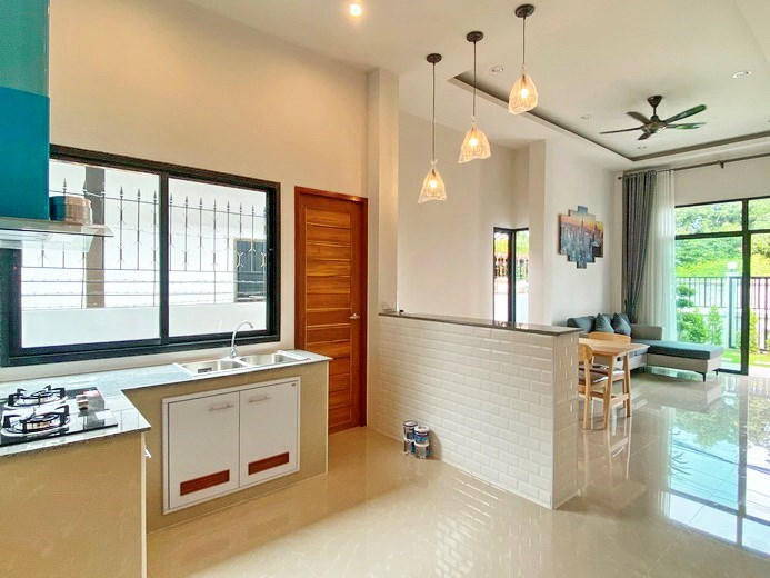 House for sale East Pattaya showing the kicthen, dining and living areas