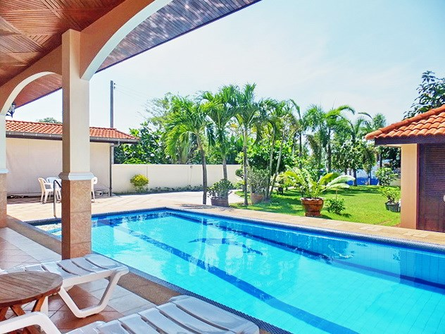 House for sale East Pattaya showing the covered terrace, pool and garden