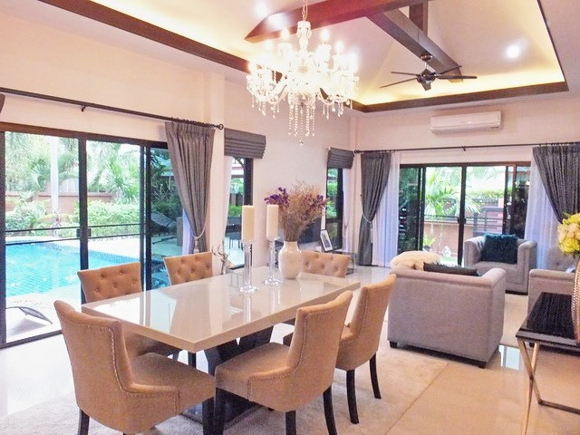 House for Sale Pattaya showing the dining and living areas with pool view