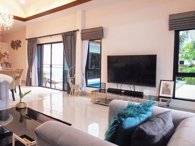 House for Sale Pattaya showing the living area with pool view